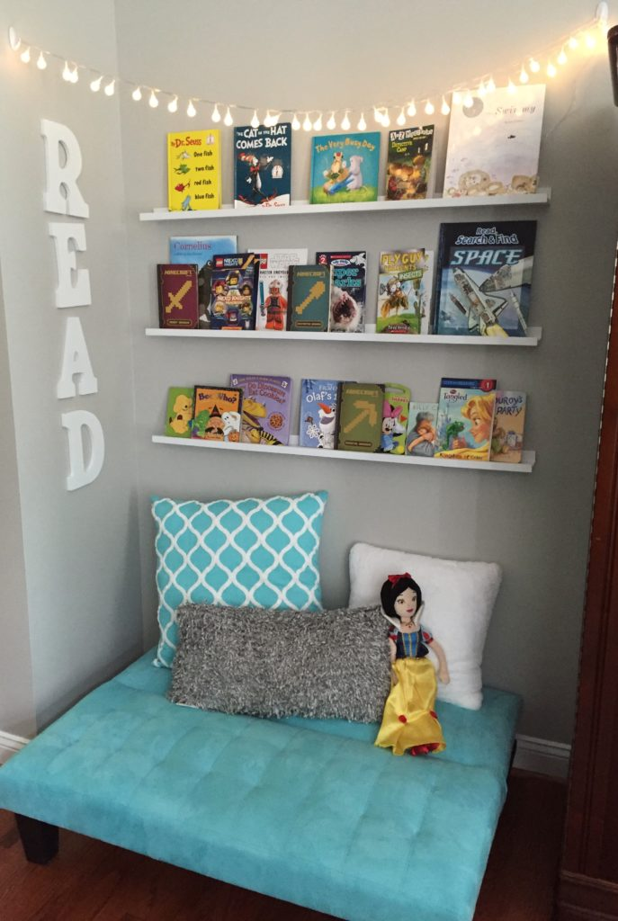 Create this simple reading nook with a child's futon, shelves, string lights and throw pillows.