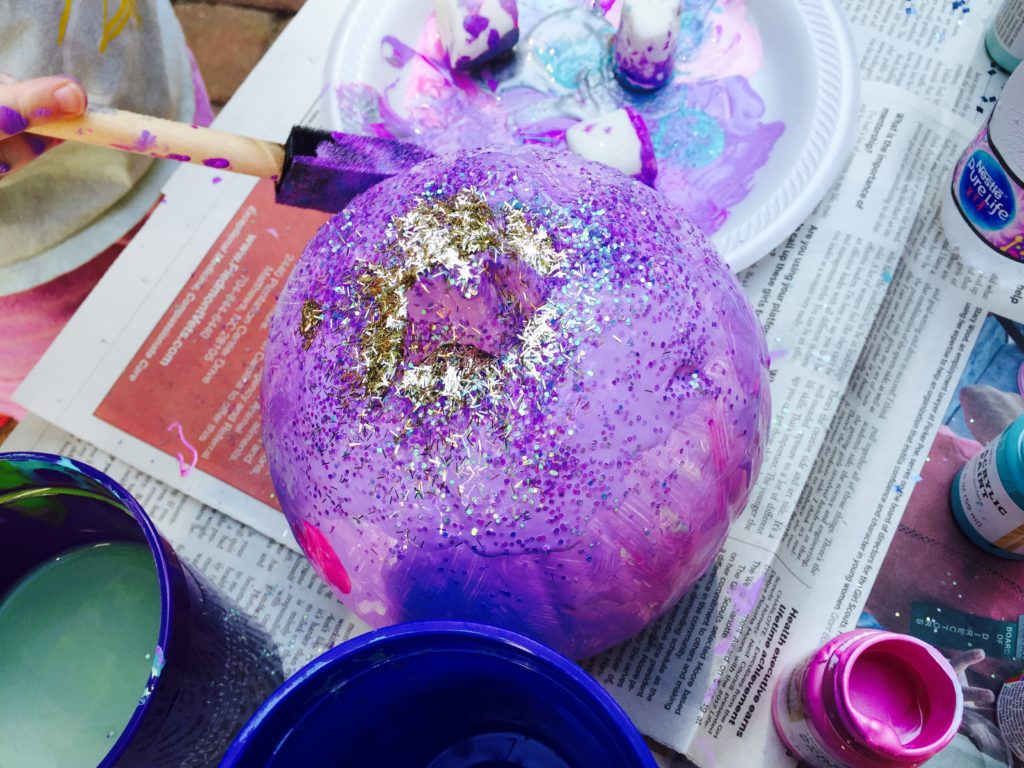 Add glitter to the painted pumpkins to add sparkle