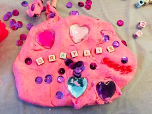 Fairy Princess Invitation to Play using Dollar Tree beads, gems, sequins and tray along with toys and cloud dough.