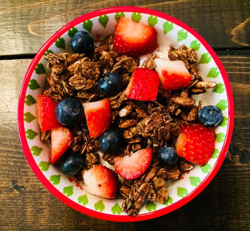 Chocolate granola with yogurt and berries