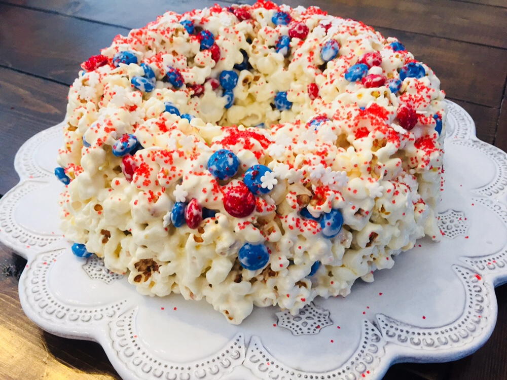 The recipe for Patriotic Popcorn Cake is so simple and perfect to make with kids. You only need a few ingredients and it would be perfect to take to a picnic or 4th of July party!