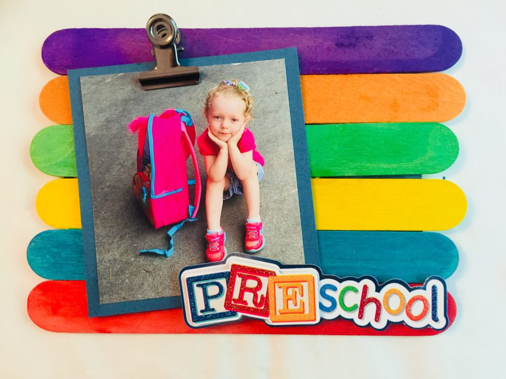 Display those cute first day of school pictures with this easy back to school popsicle stick frame craft. It is so quick to make and the kids will love seeing their photo displayed.