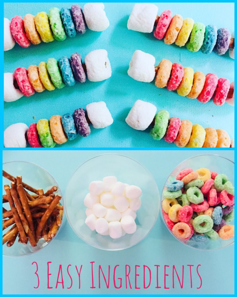 Rainbow Snack Sticks make with mini pretzel sticks, fruit loops, and mini marshamallows. A fun snack craft for kids to make!