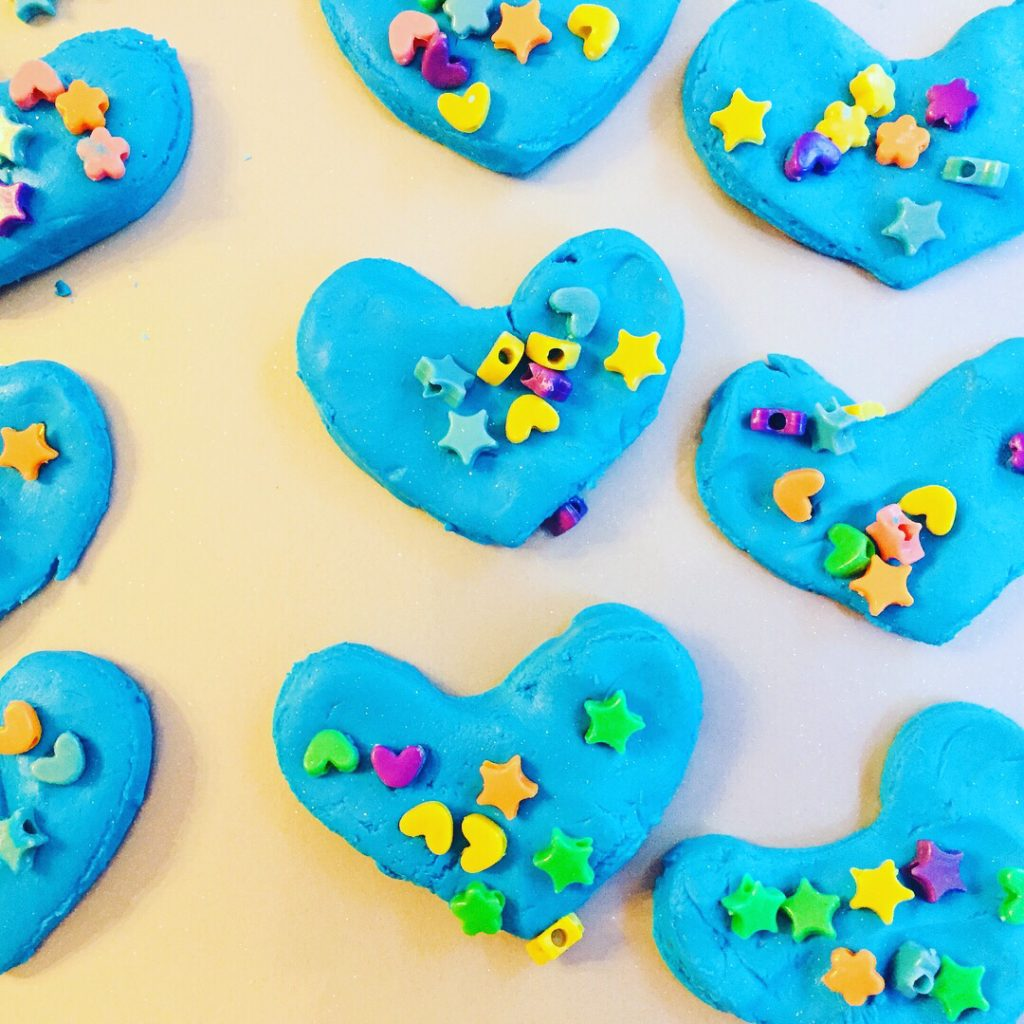 Book Activity Craft based on Have You Filled A Bucket Today. Kindness hearts make from blue sparkly cloud dough.