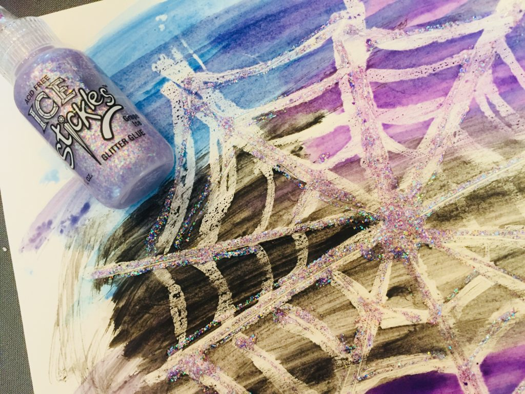 Watercolor Resist Glitter Spider Web Art - A fun and sparkly Halloween craft for kids of all ages!
