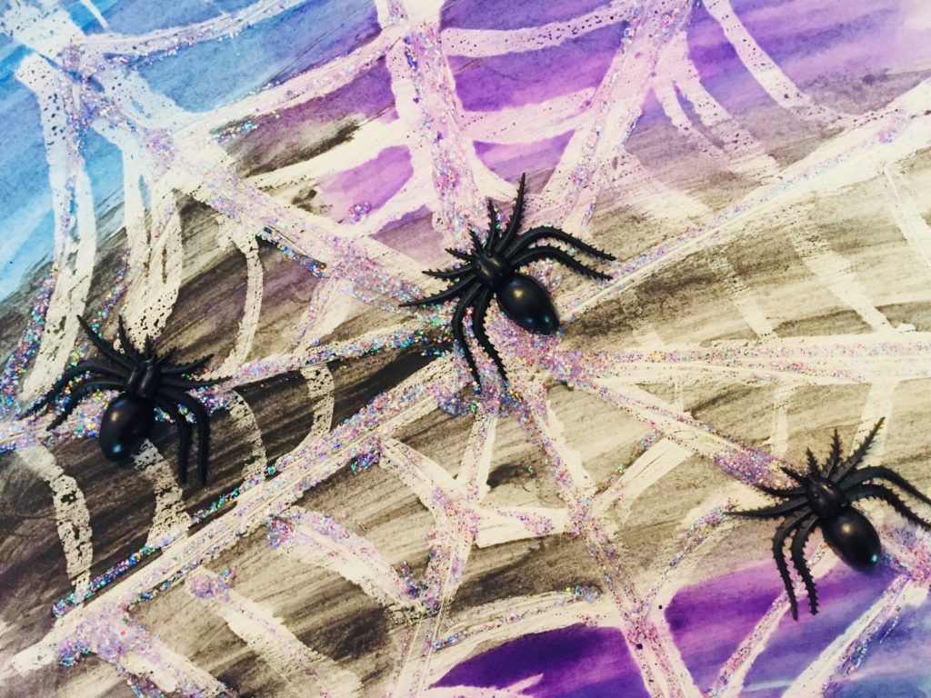 Water Color Resist Glitter Spider Web Art - A fun and sparkly Halloween craft for kids of all ages!