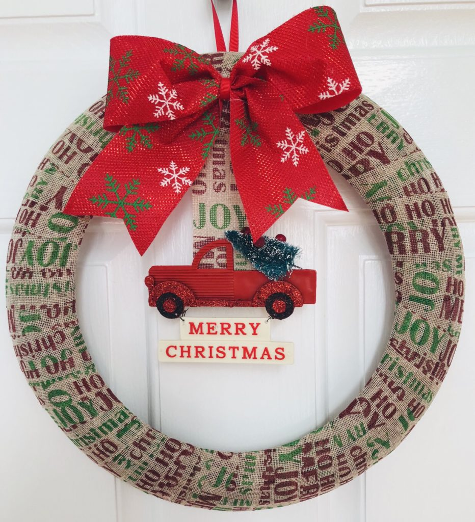 Simple Dollar Tree Christmas Wreath using burlap ribbon and an ornament.