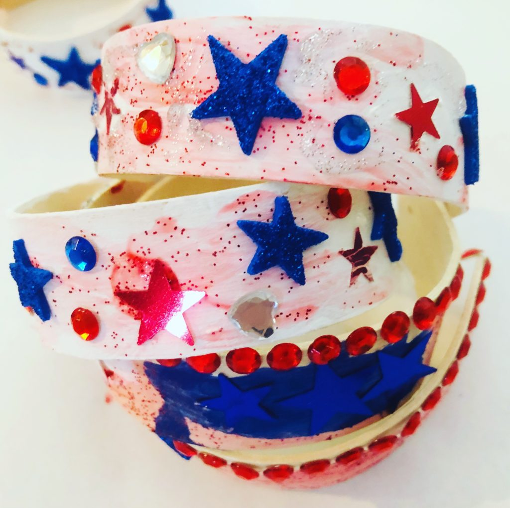Patriotic Popsicle Stick Bracelets - such a fun craft with lots of bling! Perfect for Memorial Day or 4th of July crafting.
