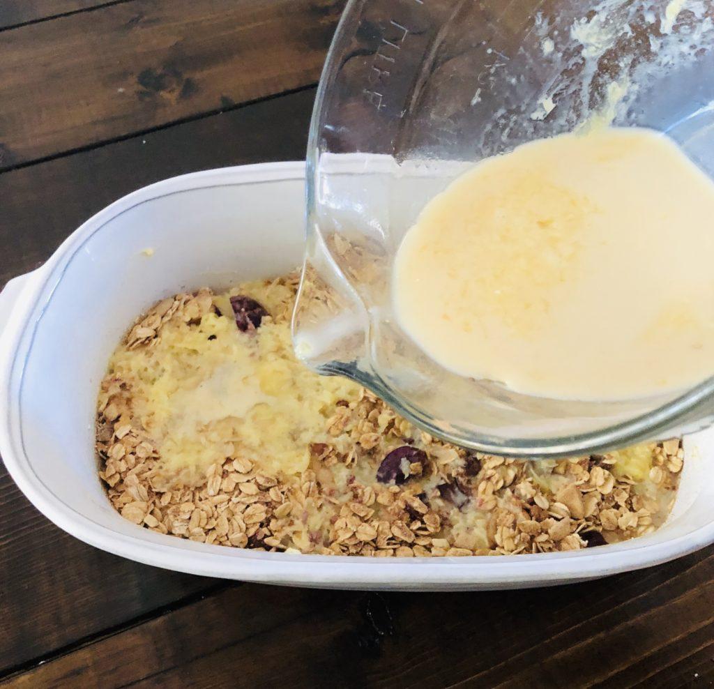 Pour wet mixutre into the casserole dish.