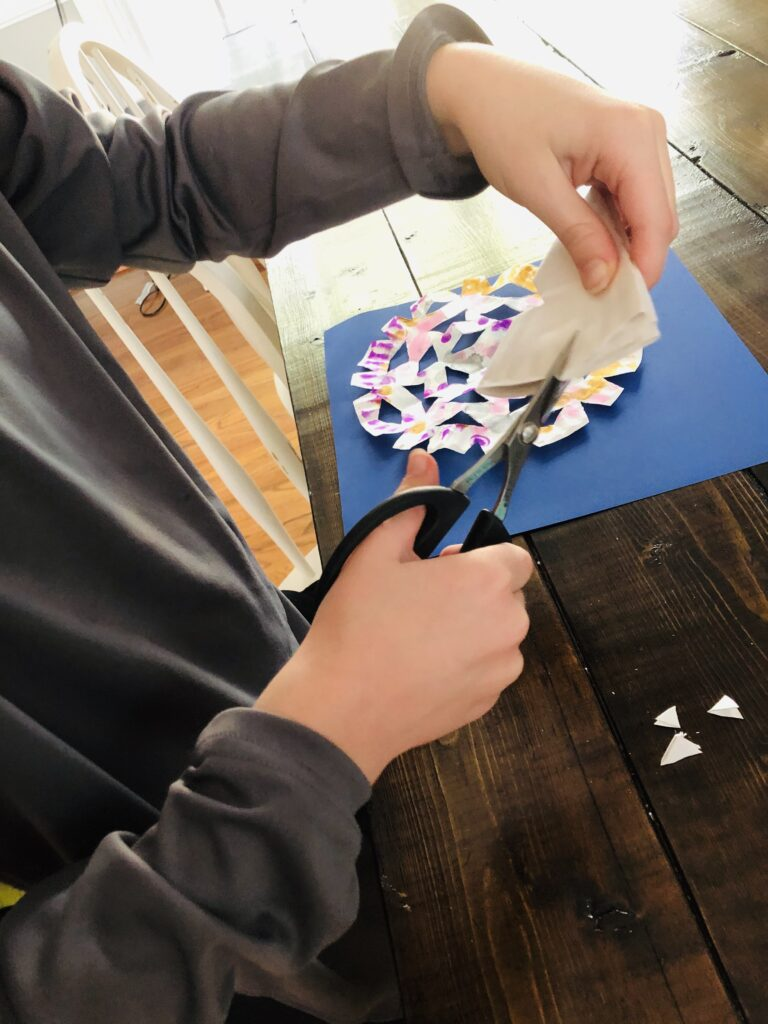Cutting to create paper snowflakes