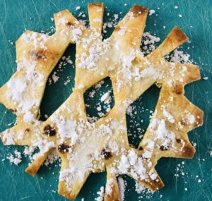 Baked Snowflake Tortillas with Powdered Sugar